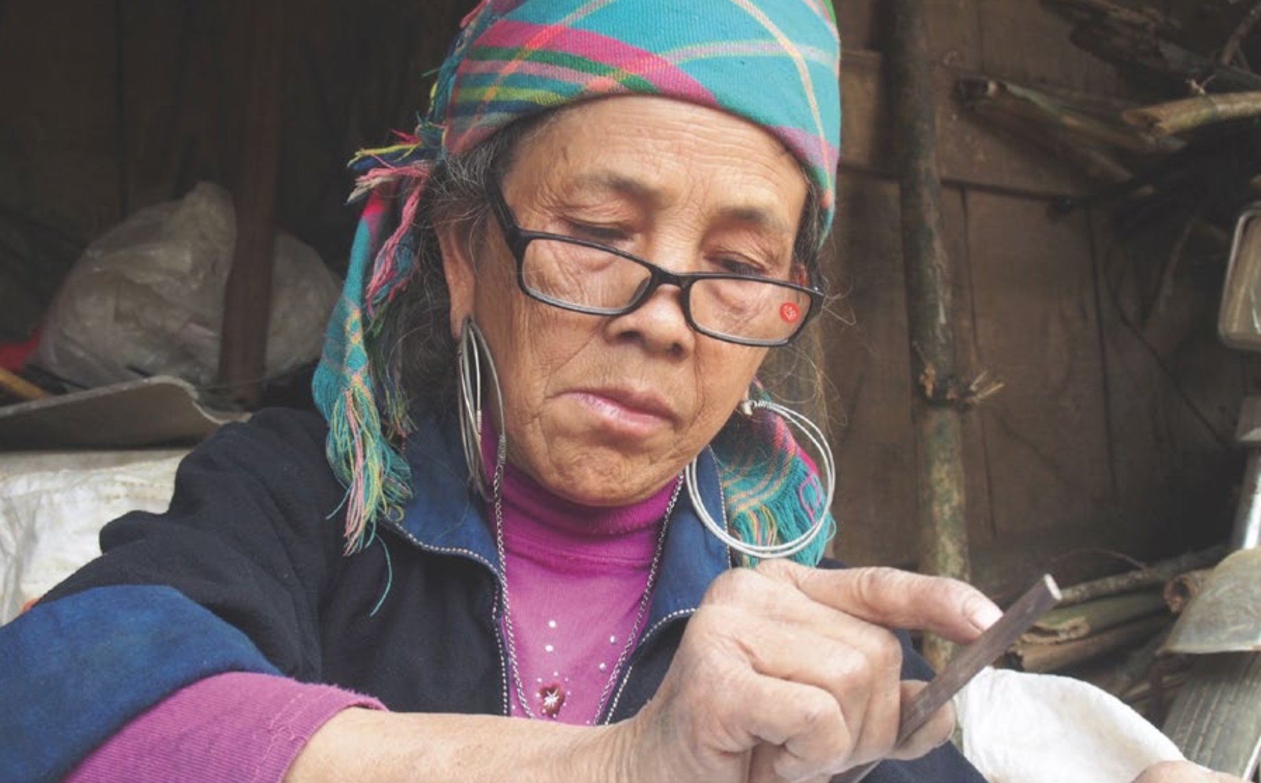 Hmong Woman crafting Saffair bags
